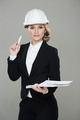Woman architect with drawings. Beautiful girl in a building helmet