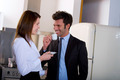 couple at home man drinking coffee before going to work
