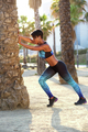Sporty young woman stretching muscle exercise