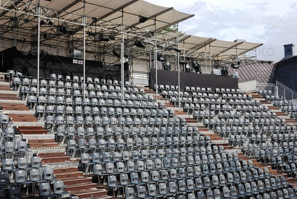 rows of empty black plastic seats - Stock Photo - Images