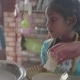 Young Adorable Indian Girl Helping With Cooking