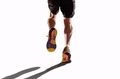 athletic legs and running shoes of sport man jogging in fitness healthy advertising style