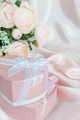 Festive composition with camellias and gift box