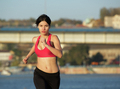 Healthy young sports woman running outdoors