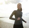 Female runner exercising by the beach