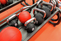 close up of kettlebells and medicine ball in gym