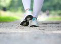 Woman walking in running shoes outdoors