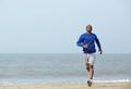 Athletic man enjoying a jog at the beach