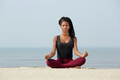 Woman sitting in yoga lotus pose
