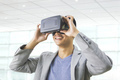 asian man wearing virtual reality goggle