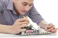 young technician fixing computer hardware