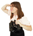Business woman with binoculars looking into the distance