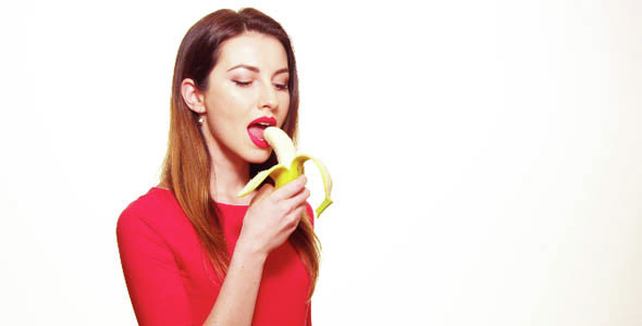 Sexy Woman In Red Clothes Eating Banana On White -9655