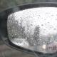 Rain Drops On The Rear View Mirror