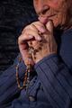 Grandmother praying.