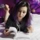 Teenage Girl Reading On Bed