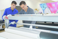 Two men in inductrial printing shop