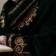 An Old Mullah In National Dress Reading The Koran