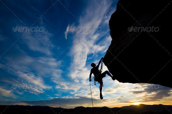 Rock climber rappelling. - Stock Photo - Images