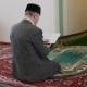 An Old Mullah Reading The Koran