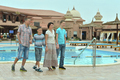 Family near swimming pool