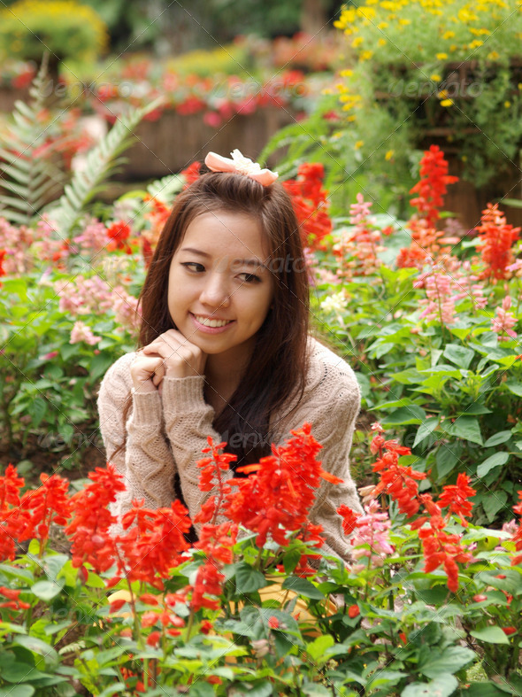 A smile of Asia beautiful girl  on a colorfull flower background - Stock Photo - Images