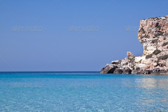 Blue sea of Lampedusa, Sicily.  - Stock Photo - Images