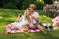 Happy couple having a picnic and embracing in the garden