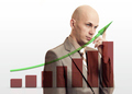 Businessman drawing rising graph, development and growth concept