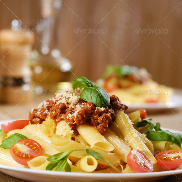 Pasta rigatoni on the white plate - Stock Photo - Images