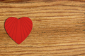 Red felt heart on grey wooden background