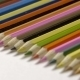Line Of Colour Pencils Isolated On White Background