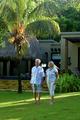 Beautiful happy elderly couple walking outdoors