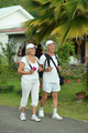 Elderly couple with backpacks in the journey