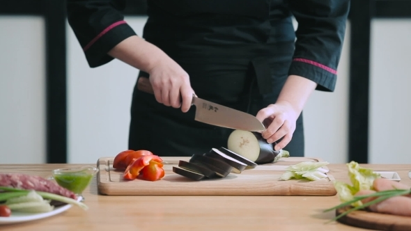 Professional Chef Cutting Eggplant By Photo Oles Videohive