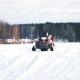 Young Father And Son On Snowmobile