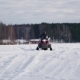 Young Man With His Brother On Snowmobile