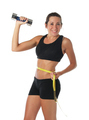 Healthy lifestyle. Fitness woman with a measuring tape