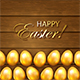 Set of Golden Easter Eggs on Wooden Background
