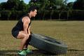 sport man lifting tire