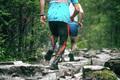 runners climb uphill