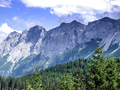 Alpine landscape: the view over the green valley, mountains and