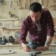 Master Thoughtfully Works In a Carpentry Workshop