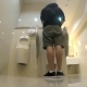 Man Peeing In Toilet With Urinals.