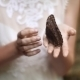 Girl Bride Hands Holding Butterfly Outdoors