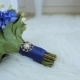 Bride Bouquet Of Blue Flowers Tied With Satin Ribbon