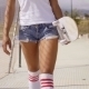 Lower Front Half Of Female Skater Wearing Shorts