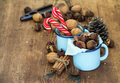 Traditional Christmas foods and decoration. Roasted chestnuts in blue enamel mug