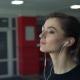 Girl With Headphones On a Treadmill