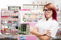 Redhead pharmacist inside the drugstore